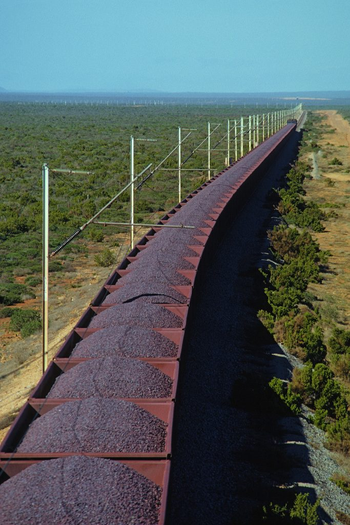 Loaded iron ore train on remote electrified railway